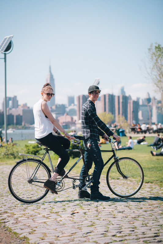 ride a homemade tandem bike  photographed at East River State Park, Kent Ave. and N. 8th St., Brooklyn  en route to a picnic