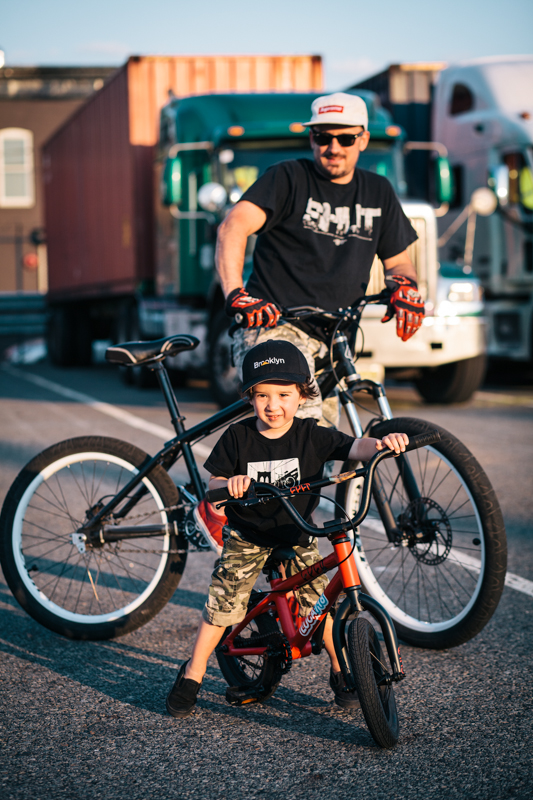 Jeff rides a Brooklyn Machine Works single-speed park bike  Luca rides a Cult BMX bike  photographed at the Red Hook Cruise Terminal, Brooklyn  while taking pictures of the trucks