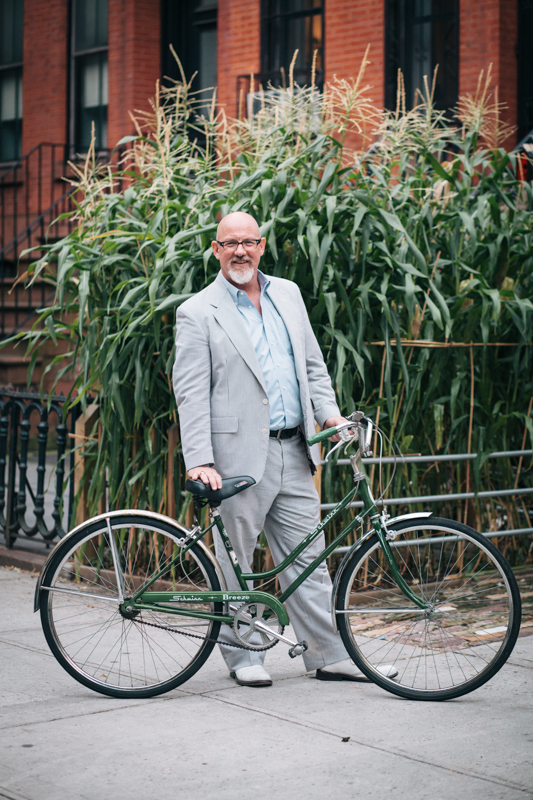 rides a Schwinn Breeze 3-speed bicycle circa '73 photographed at Adelphi St. and Willoughby Ave., Brooklyn  heading home from work