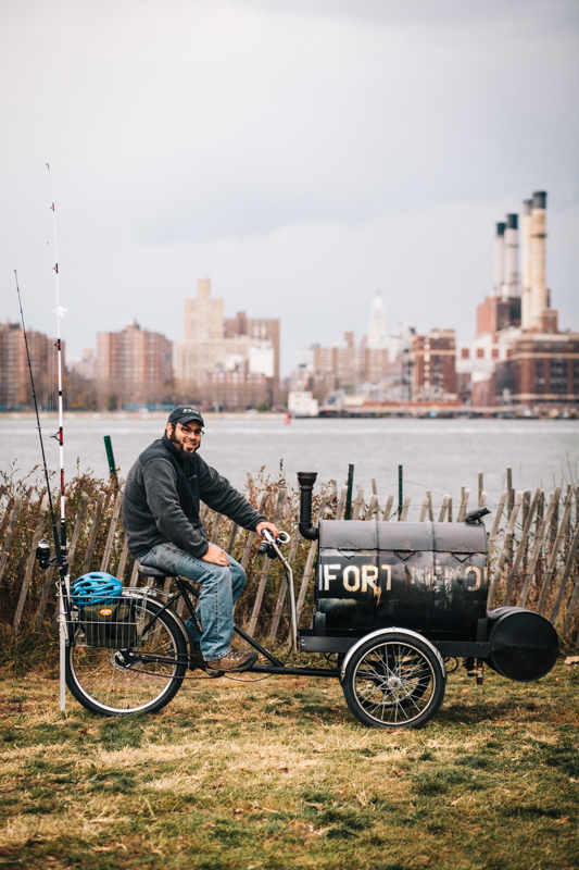 rides a Workman Cycles custom welded former ice cream delivery bike photographed at East River Park, Brooklyn  en route to the Brooklyn Fishing Derby