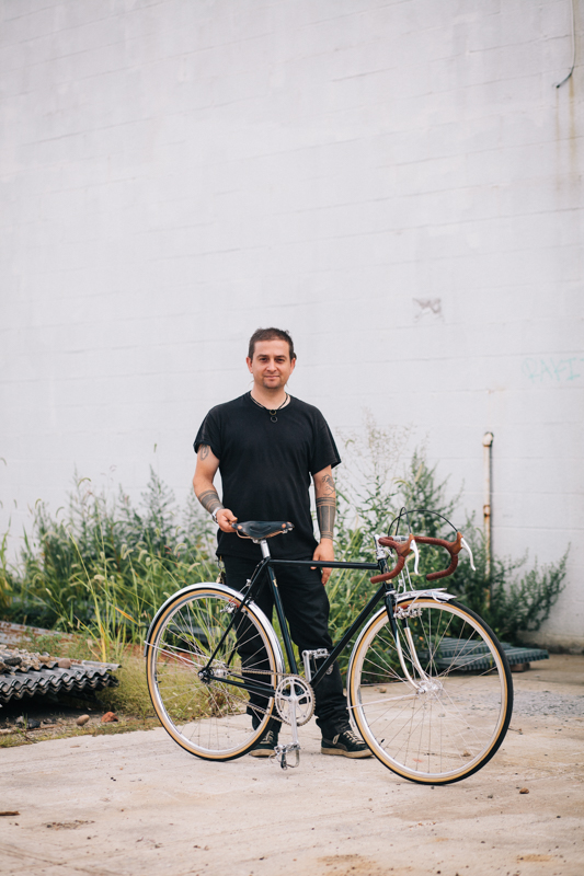Johnny  with a Coast Cycles fixed gear bike  photographed at the Knockdown Center in Maspeth, Queens  while exhibiting at the Bike Cult Hand-Built Bike Show