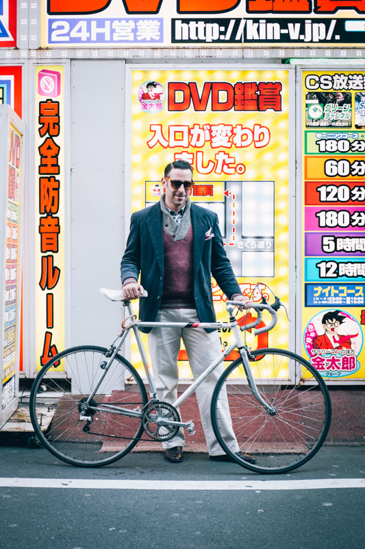 rides a Bridgestone 10-speed bicycle in Tokyo